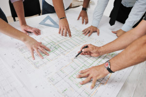 Team of architects people in group  on construciton site check d